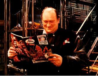 Peter Wragg, on the set of Red Dwarf, wearing a Red Dwarf jacket, reading the Red Dwarf Smegazine.