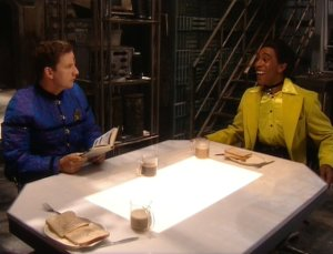 Screengrab from Tikka - Cat and Rimmer sitting at the scanner table