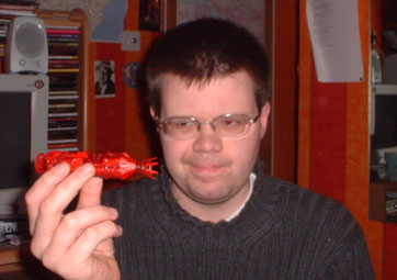 John holding the Corgi Red Dwarf model disapprovingly. What an ugly cunt.