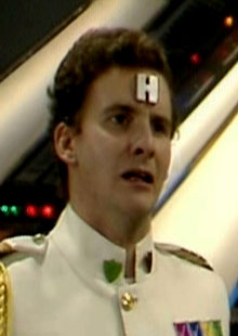 Rimmer looking distraught.