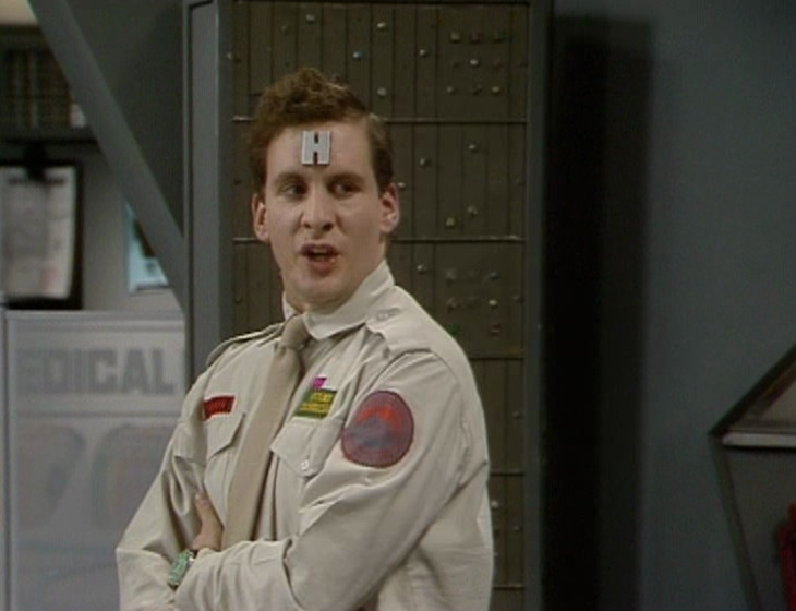 Rimmer in the Drive Room with the Captain's Office/Medical Unit set in the background