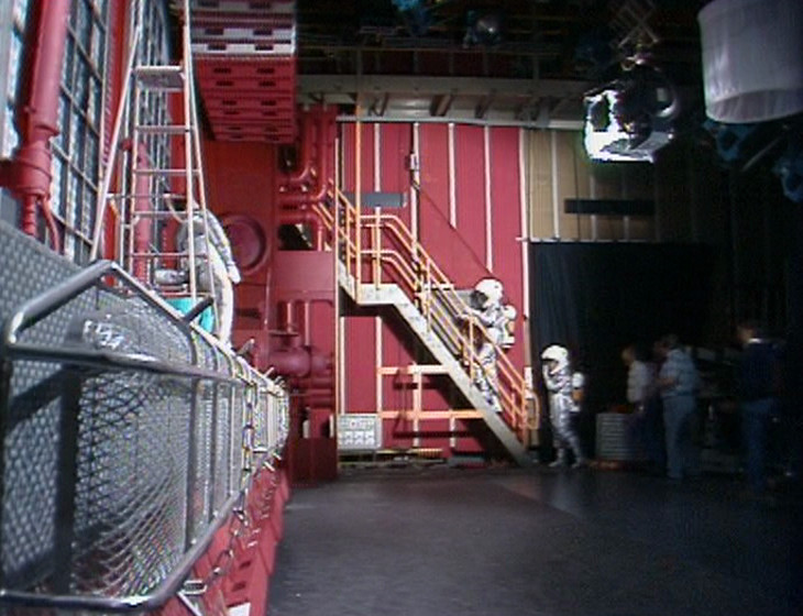 Behind the scenes of Confidence and Paranoia, showing the studio wall