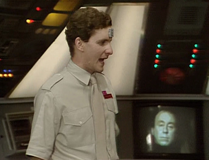 Rimmer in the Drive Room with Holly in the background