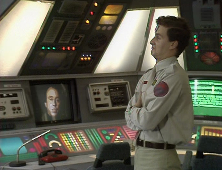 Rimmer in the Drive Room with Holly in the background again