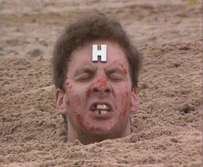 Close-up of Rimmer, annoyed