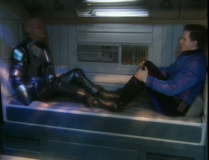 Kryten and Rimmer preparing to go into deep sleep