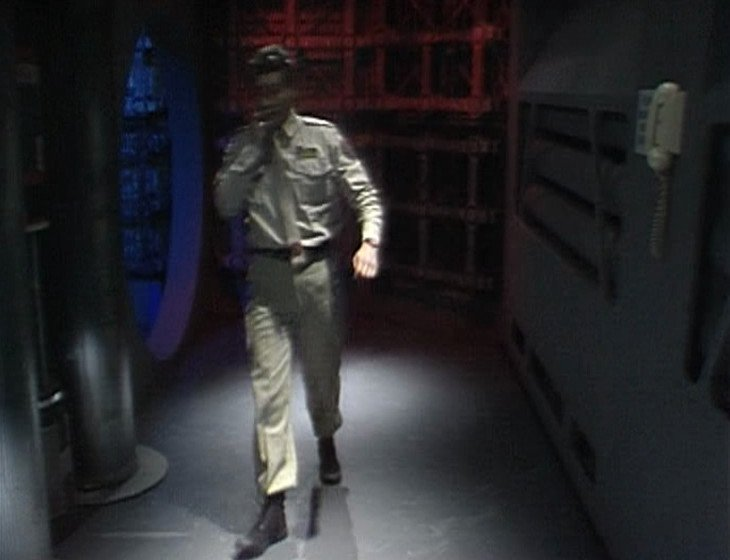 Rimmer walking down a corridor