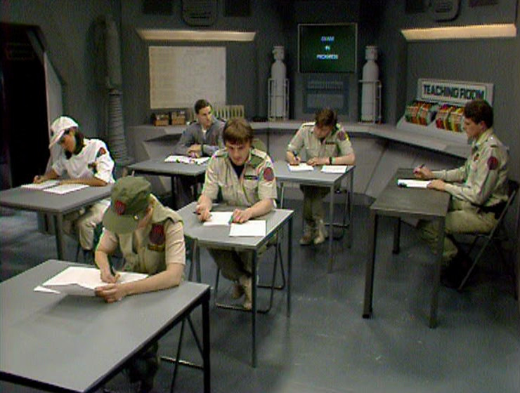Rimmer sitting in the Teaching Room for his exam